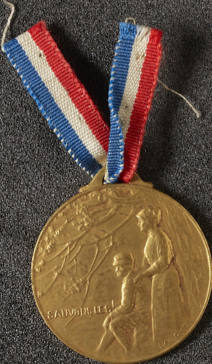 Gilt bronze medal with ribbon sold in aid of the w