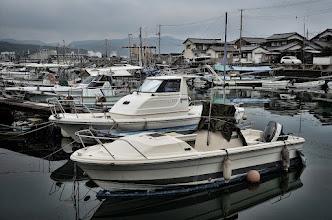 Photo: Boats docked at a marina in Kojima, Japan