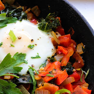 Shakshuka – Baked Eggs in Tomato Stew with Greens (Low-FODMAP, Paleo).