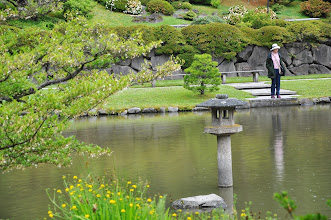 Photo: Carole Slesnick enjoys the pond at the Seattle Japanese Garden.