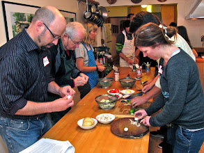 Photo: all class members help prepare ingredients for the evening's dishes