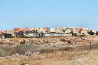 Photo: The nearby settlement. Every year it is growing and comes more close to Al-Twani.