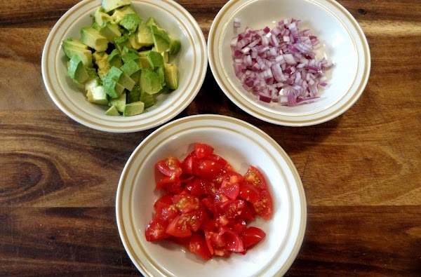 Prep the veggies and cheese.  Dice the avocado.  Finely dice the red...