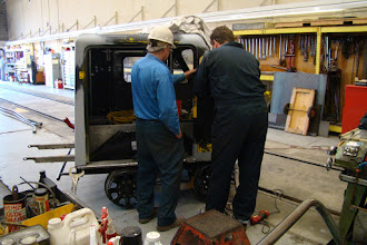 Photo: Ross and Jack working on installing the right door front support brace/strut.