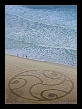 Photo: 'Celtic Swirls', Ocean Beach, SF. 3 waves, 3 beach walkers, 3 spirals.