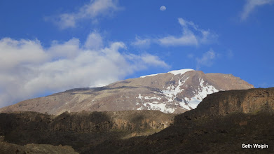 Photo: Almost a full moon over Kili from Moire Camp. The summit looks close enough to run up. (not).