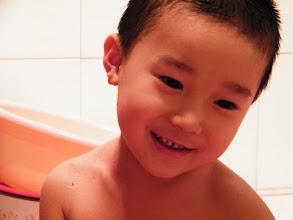 Photo: baby in bath.