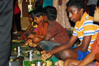 Photo: Enjoying the Prasadam