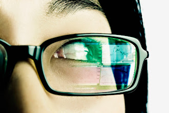 Photo: Extreme close-up of a young woman wearing eyeglasses --- Image by © Royalty-Free/Corbis