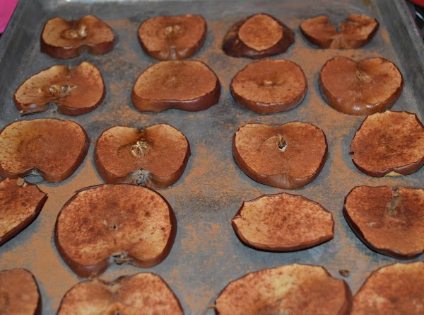Place on cookie sheets and place in the oven, for 3 hours, flip apples...