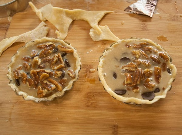 Add about ¼ cup of the mixture to each of the cooled tartlet shells,...