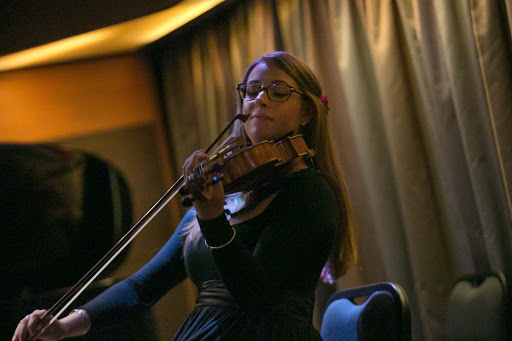 Sarah Greene on viola during a Lincoln Center Stage performance on Oosterdam.