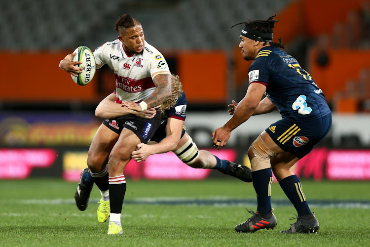Elton Jantjies of the Lions is tackled during the round 12 Super Rugby match between the Highlanders and the Lions at Forsyth Barr Stadium on May 12, 2018 in Dunedin, New Zealand.