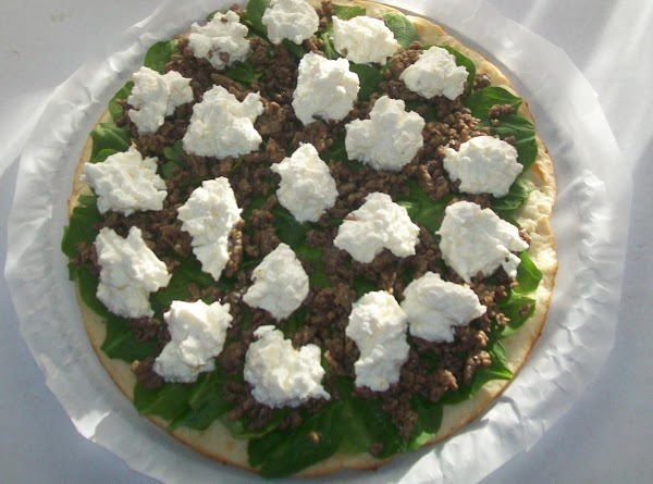 Lay the crust on a pizza pan, top with the fresh spinach, top the...