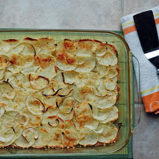 Crispy Parmesan Potatoes with Onions and Garlic