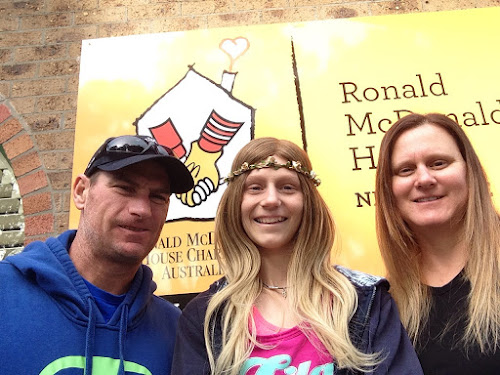 Grateful family: Stephanie Stuart, centre, with her parents Glenn Stuart and Danielle Bird at Ronald McDonald House in Newcastle on Monday.