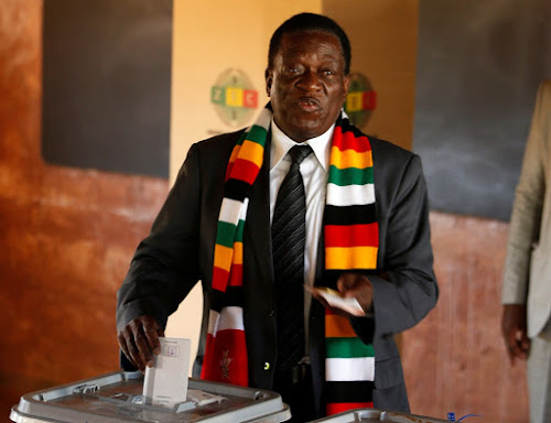 Zimbabwe's President Emmerson Mnangagwa casts his ballot as he votes in the general election at Sherwood Park Primary School in Kwekwe, Zimbabwe on July 30 2018.