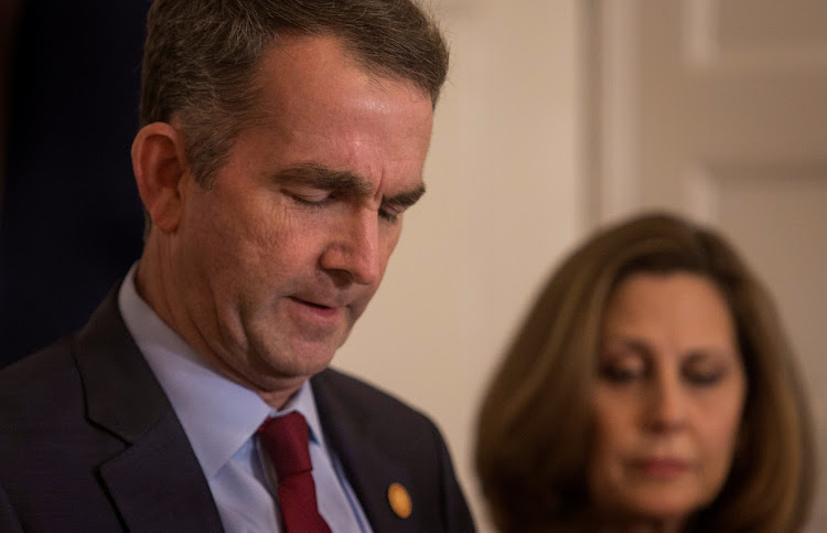 Virginia Governor Ralph Northam, accompanied by his wife Pamela Northam announces he will not resign during a news conference in Richmond, Virginia, US.