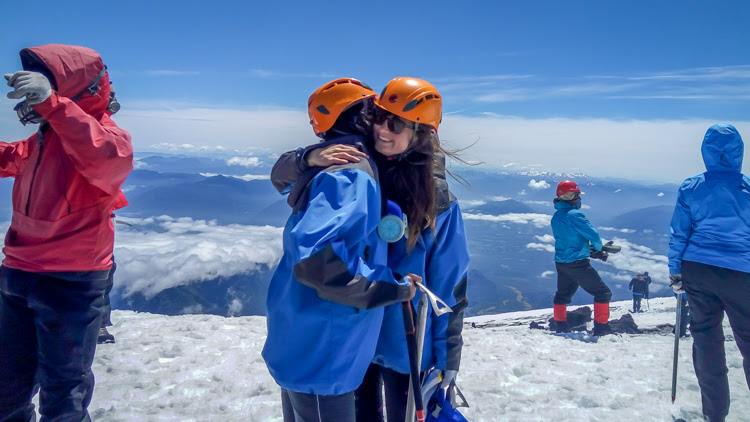 congratulating each other at the top of the volcano villarrica after completing the villarrica volcano hike