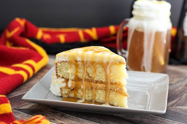 Slice Of Butterbeer Cream Cake On A Plate.