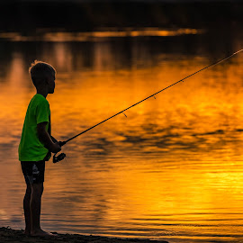 Sunset Fishing by Chad Roberts - Babies & Children Children Candids ( water, reflection, sky, sunset, gold, fishing, evening, boy,  )