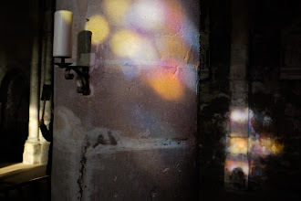 Photo: Colored light filters through the stained glass inside the church