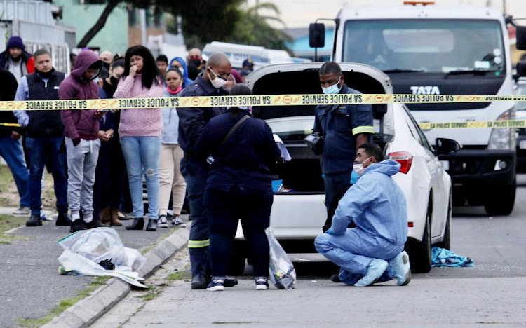 The scene outside Lt-Col Charl Kinnear's house in Bishop Lavis, Cape Town , on September 18 2020 after the detective was shot several times while sitting in the driver's seat of a white Toyota Corolla.