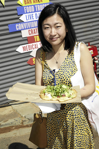 A satisfied customer at Cape Town's Visa Street Food Festival.