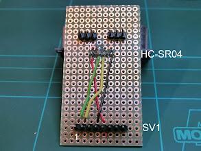 Photo: Adapter Pinout:  HC-SR04            AAR04 (SV1) 1      VCC (red)        5 2     Trigger (green)   1 (D8) 3      Echo (yellow)    2 (D4) 4      GND (black)     4