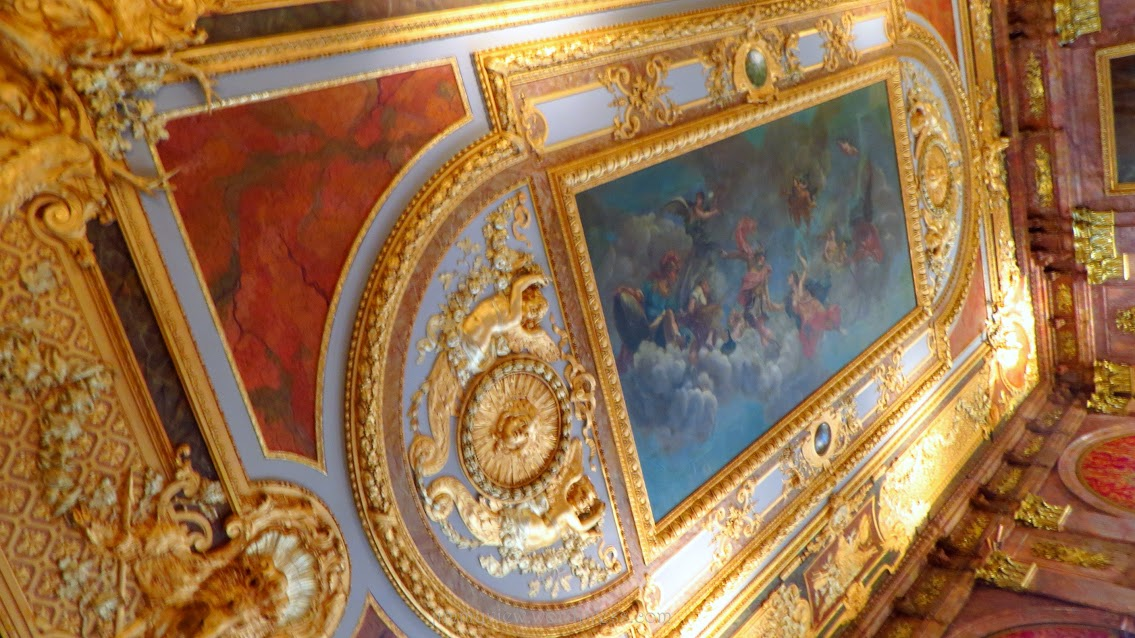 Elaborate painting on the ceiling.