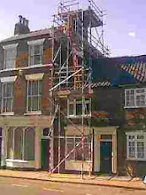 Photo: The cottage in North st I rented, being saved from the 16ft chimney next door.