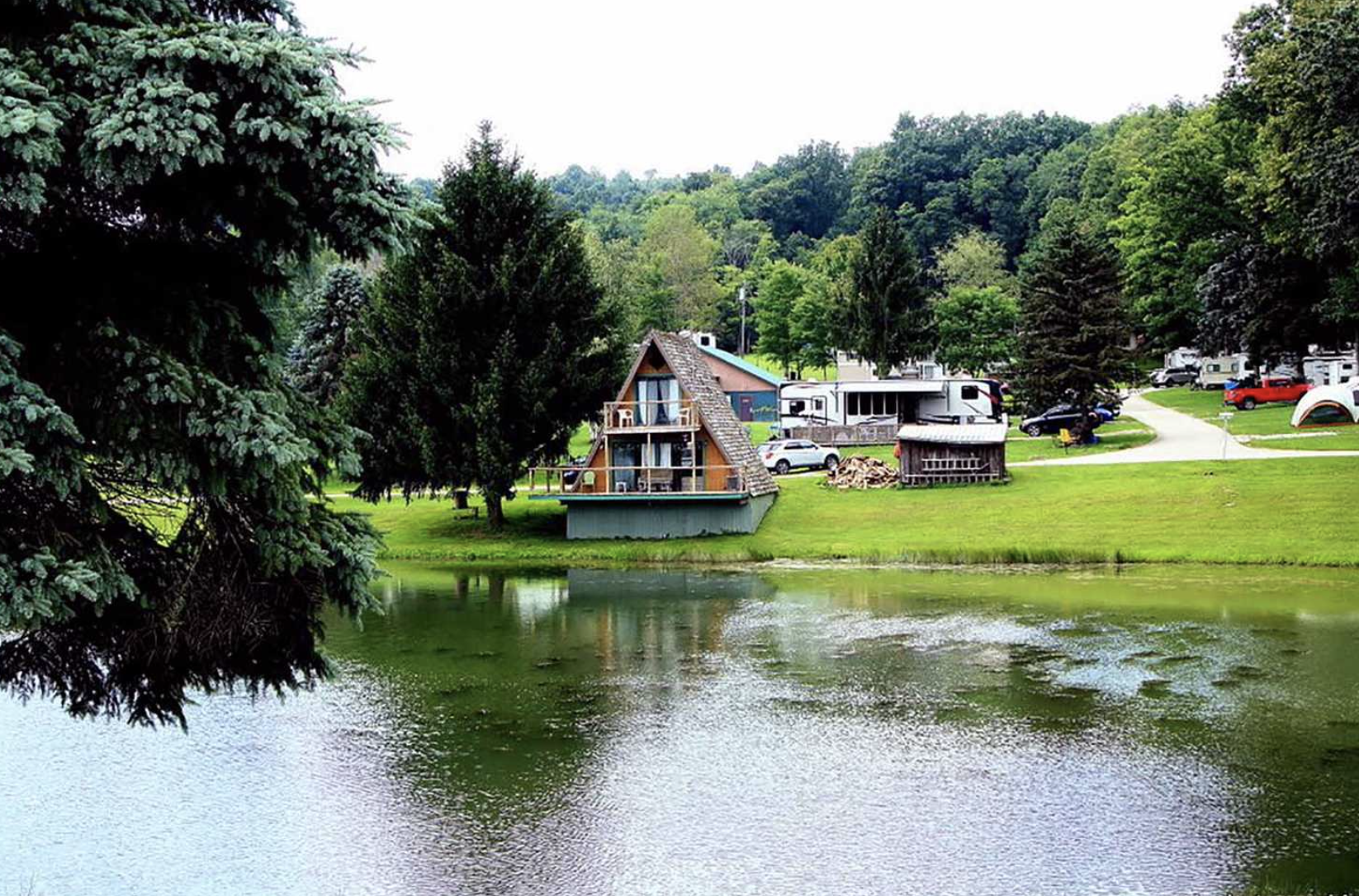 Cabin on the lake with RVs in the background