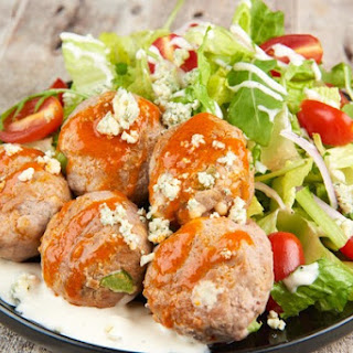 Buffalo Turkey Meatball Salad with celery and blue cheese
