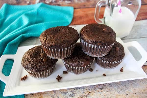 Chocolate Zucchini Muffins On A Platter.