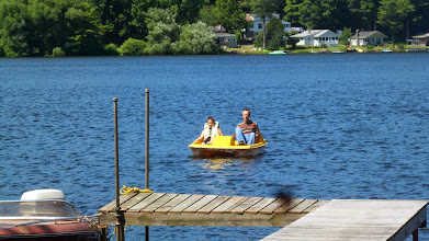 Photo: Jim and Ethan coming in from a paddle boat ride.