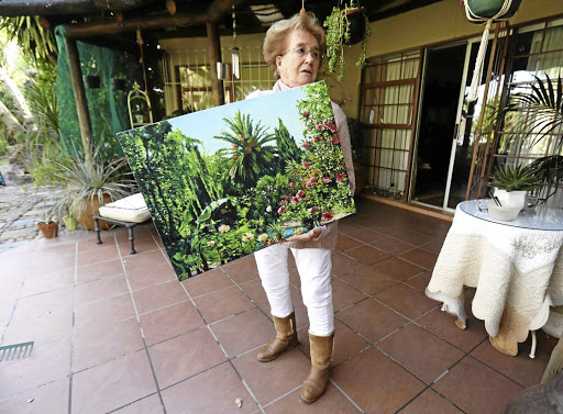 Upington guesthouse owner Jackie Castella with a garden scene by Meyer. Pictures: Esa Alexander