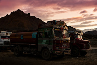 Photo: This is a photo from one of the major resting areas on the Manali-Leh Highway in the Indian Himalayas. Initially, we were very scared of these colorful trucks since bad roads, bicycles and speeding trucks don't mix very well. On our second day in the saddle, we discovered that a friendly greeting made a world, or at least half a meter, of difference. We greeted each truck with a simply wave, which generally resulted in a loud honk, a bit more space between us, and a big smile on driver's face.
