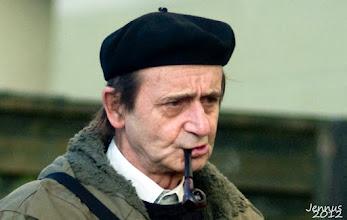 Photo: Mann mit Mütze und Tabackpfeife