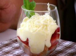 Beat the remaining cream until firm peaks form. Divide the whipped cram between the...