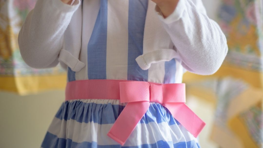 new blue and white striped Easter dress with white cardigan and pink bow