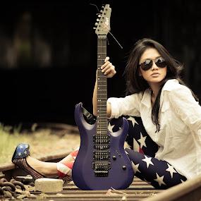 Strings on the rail by Putu Anggara - People Portraits of Women ( railway, string2, rock, guitar, beauty )