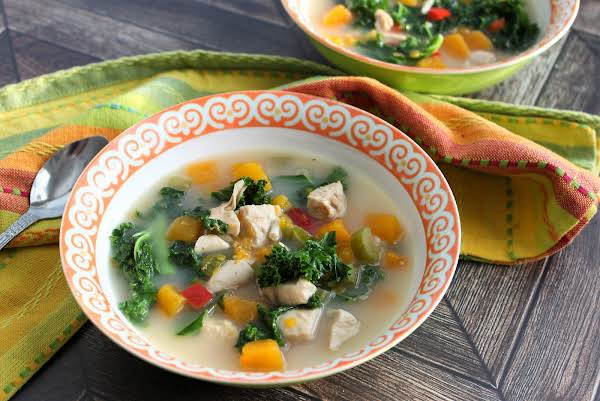 A Bowl Of Creamy Chicken And Butternut Squash Soup.