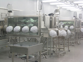 Photo: The Lunar Sample Laboratory.   Work tables, when not in active use, have dust-covers over the arm holes.