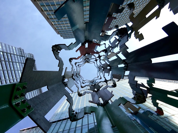 "Looking up from the middle of ""Human Structures (San Francisco)"" by Jonathan Borofsky."