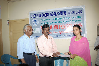 Photo: Mr.Arul presenting the certificate to a young girl who has successfully completed the digital training