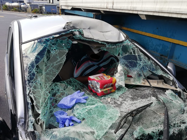 A six pack ended up on the bonnet of this badly damaged car when the driver fled a roadblock in Cape Town and crashed into a truck. Police suspect he was under the influence of pre-Christmas drinking.
