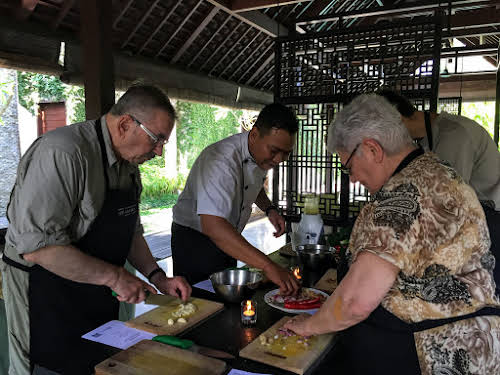 Indonesia. Bali Cooking Class. Slicing, cutting and mincing ingredients for the Gede Paste