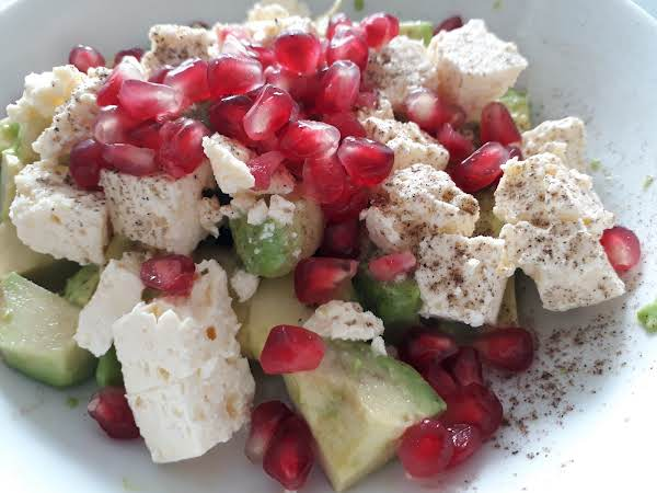 Chopped Avocado And Feta Cheese With A Sprinkle Of Pomegranate Rubies.