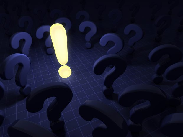 Image of a lighted exclamation point in the middle of question marks - represents schoolteacher who made a million dollars with a simple idea