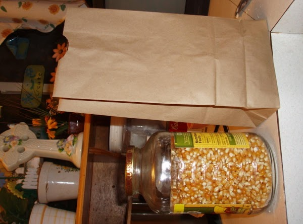 one Brown paper bag and pop corn as seen in picture. I buy the...